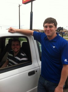 Preston (in the driver's seat) and his friend, Wesley
